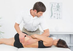 bigstock-male-physiotherapist-massaging-55568837-compressor